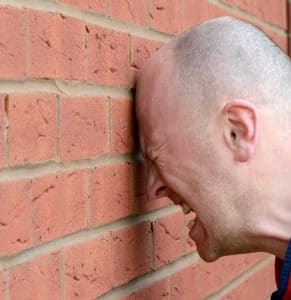 Our Consultant Headbutting a Wall after reading yet another dreadful accountancy CV